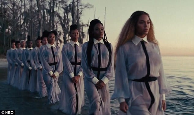 New chapter: Beyoncé then leads a group of women into the water in a baptism-like scene as she decides to start fresh in her relationship Read more: http://www.dailymail.co.uk/news/article-3555902/Beyonce-doubles-Black-Lives-Matter-theme-featuring-powerful-images-mothers-Trayvon-Martin-Michael-Brown-new-visual-album-Lemonade.html#ixzz46lW9qxLa Follow us: @MailOnline on Twitter | DailyMail on Facebook