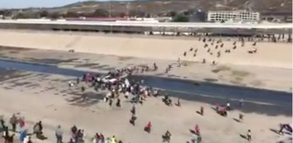 BREAKING VIDEO: HUNDREDS Of Illegal Caravan Members RUSH Port Of Entry In CA